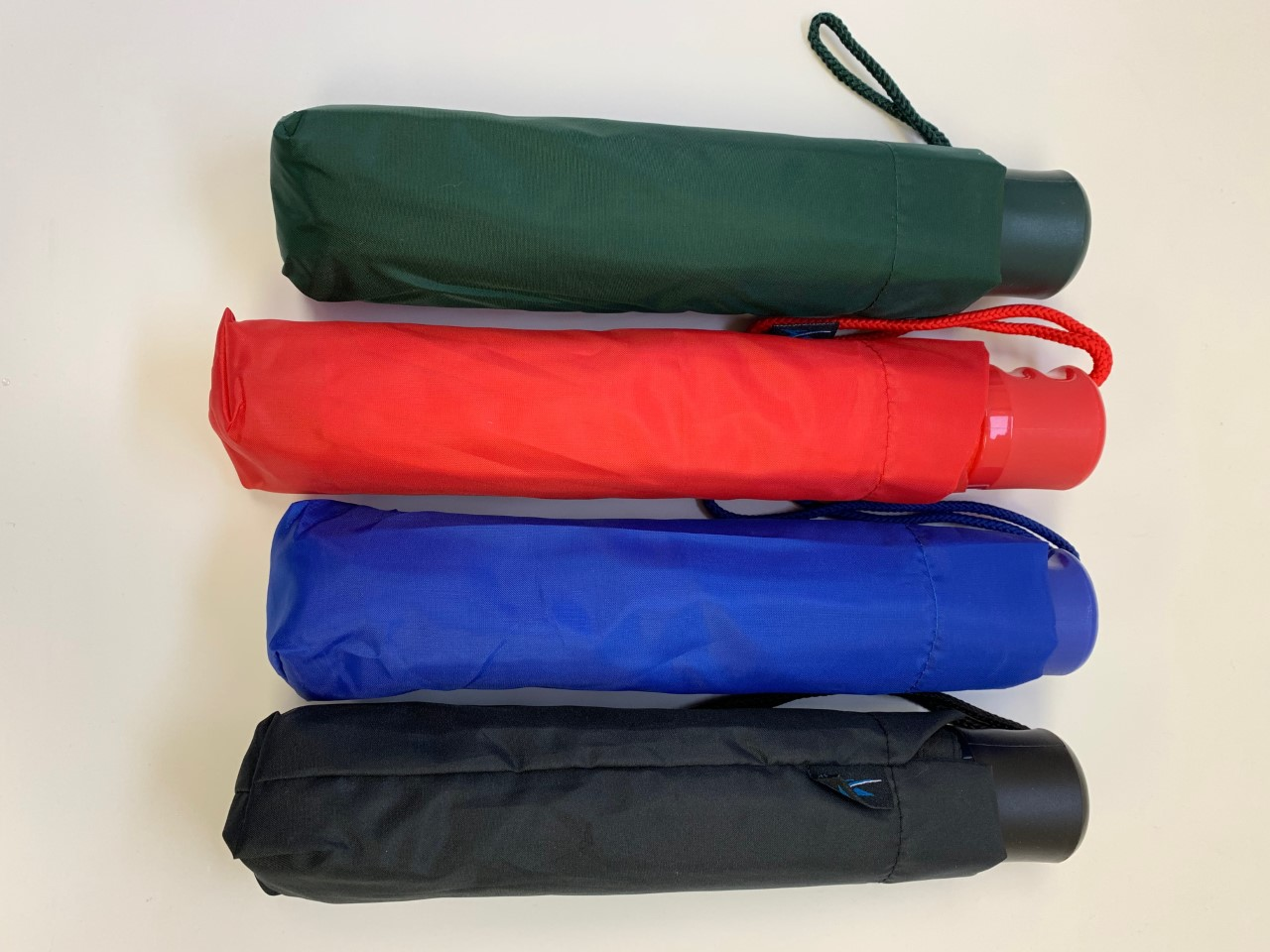 Image for the Storm Dud Mini Umbrellas in assorted colors product